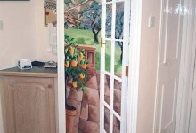 Trompe l'oeil of a Spanish view painted in a kitchen
