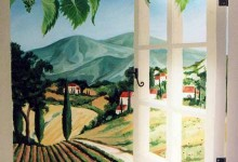 Trompe l'oeil painted window looking out on a French landscape