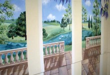 Trompe l'oeil mural of a landscaped garden painted on an exterior wall