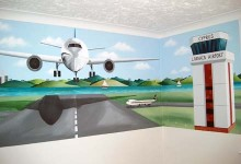 Aeroplane mural painted in boy's bedroom