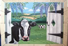 Trompe l'oeil window looking onto a field of cows