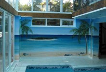 Beach scene mural painted around indoor private pool