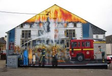 Largescale mural depicting a fire, painted in the High Street in Invergordon, Scotland