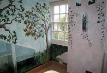 Enchanted fairy forest mural painted in a nursery