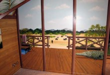 Safari themed mural painted in a boy's bedroom