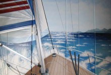 Nautical mural painted on wardrobes in a boy's bedroom in London