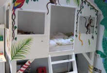 Painted jungle themed treehouse bed in boy's bedroom