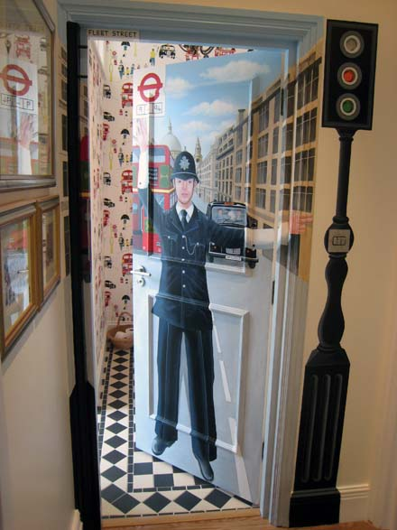 Policeman and traffic light mural painted on a bathroom door for Mural go green