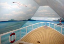 Children's mural of a sailing boat painted for a nursery