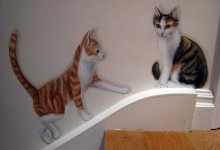 Trompe l'oeil mural of two cats walking up the stairs