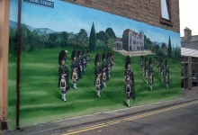 Large scale mural of Scottish Pipe Band painted on Invergordon High Street, Scotland
