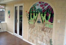 Trompe l'oeil mural of Tuscany painted in a conservatory