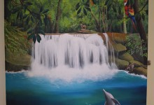 Jungle and waterfall mural painted in boy's bedroom